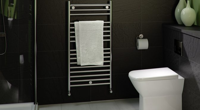A small radiator with towel in a bathroom