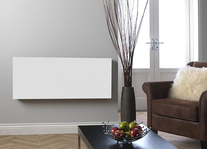 White infrared heating panel in a living room setting