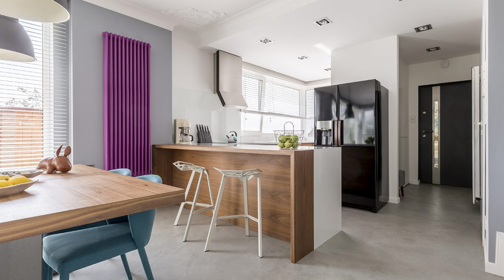 A bright purple kitchen radiator in dining area