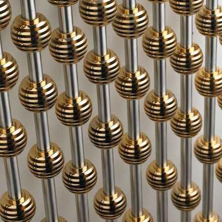 Abacus column radiator in gold