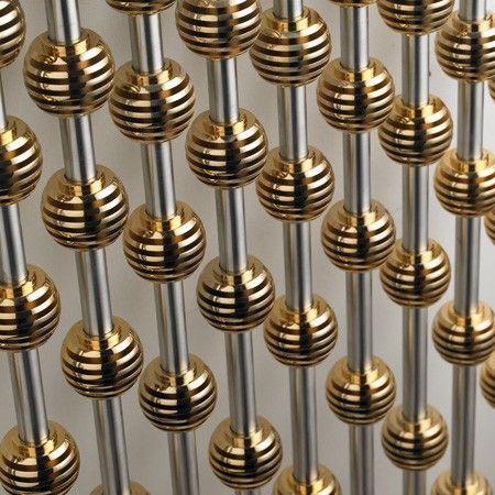 Abacus column radiator in gold